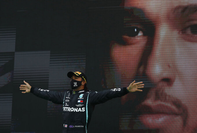 Mercedes driver Lewis Hamilton of Britain celebrates after winning the Formula One Portuguese Grand Prix at the Algarve International Circuit in Portimao, Portugal, Sunday, Oct. 25, 2020. (Rafael Marchante, Pool via AP)
