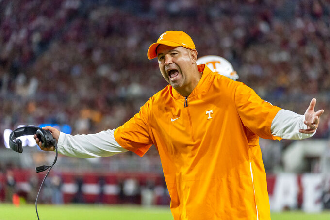 FILE - In this Oct. 19, 2019, file photo, Tennessee head coach Jeremy Pruitt yells at the officials during an NCAA college football game against Alabama in Tuscaloosa, Ala. Tennessee fired Pruitt Monday, Jan. 18, 2021. (AP Photo/Vasha Hunt, File)