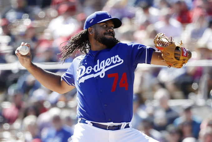 Los Angeles Dodgers relief pitcher Kenley Jansen works against a Los Angeles Angels batter during the second inning of a spring training baseball game Wednesday, Feb. 26, 2020, in Glendale, Ariz. (AP Photo/Gregory Bull)