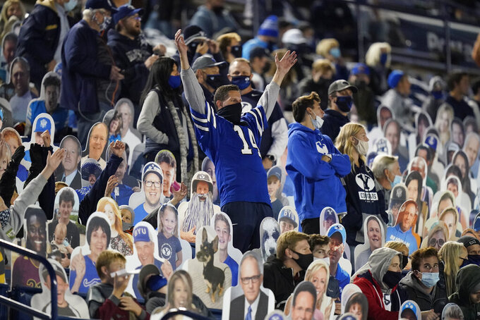 BYU fans sit among BYU cutout fans in the first half during an NCAA college football game against Texas State Saturday, Oct. 24, 2020, in Provo, Utah. (AP Photo/Rick Bowmer)