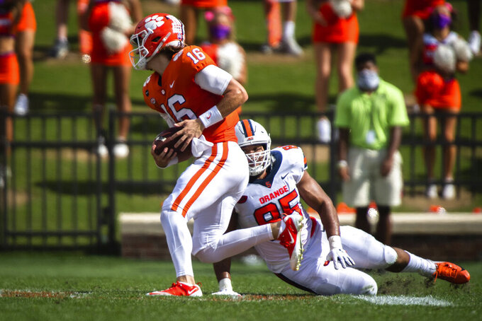 Clemson quarterback Trevor Lawrence (16) runs the ball during an NCAA college football game against Syracuse in Clemson, S.C., Saturday, Oct. 24, 2020. (Ken Ruinard/Pool Photo via AP)