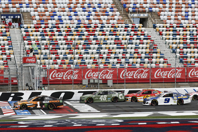 Kurt Busch (1) leads the pack as the green flag is waved at the start of the NASCAR Cup Series auto race at Charlotte Motor Speedway Sunday, May 24, 2020, in Concord, N.C. (AP Photo/Gerry Broome)