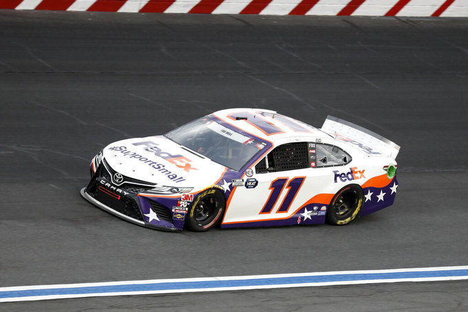 Denny Hamlin drives during the NASCAR Cup Series auto race at Charlotte Motor Speedway Sunday, May 24, 2020, in Concord, N.C. (AP Photo/Gerry Broome)