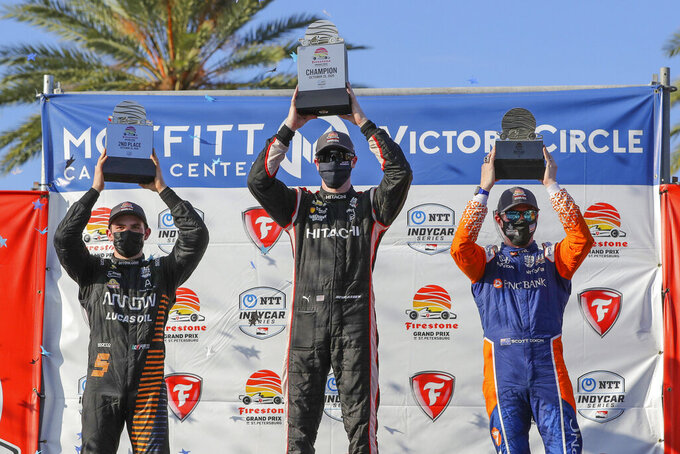 Josef Newgarden, center, celebrates his win with second-place finisher Pato O'Ward, left, and third-place finisher Scott Dixon following an IndyCar auto race Sunday, Oct. 25, 2020, in St. Petersburg, Fla. (AP Photo/Mike Carlson)